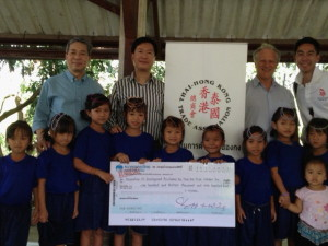 Mr. Andrew Wong, Dr. Charles Cheung and Mr. Leslie Lu present cheque to the Rescue Mission Center